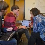 Vasantha Narayanan helps Adam Van Aken and Aaron Lowe with their scripts